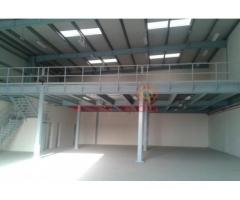 Commercial warehouse with 60,000 sq ft Openland for sale in Dubai Investment park.